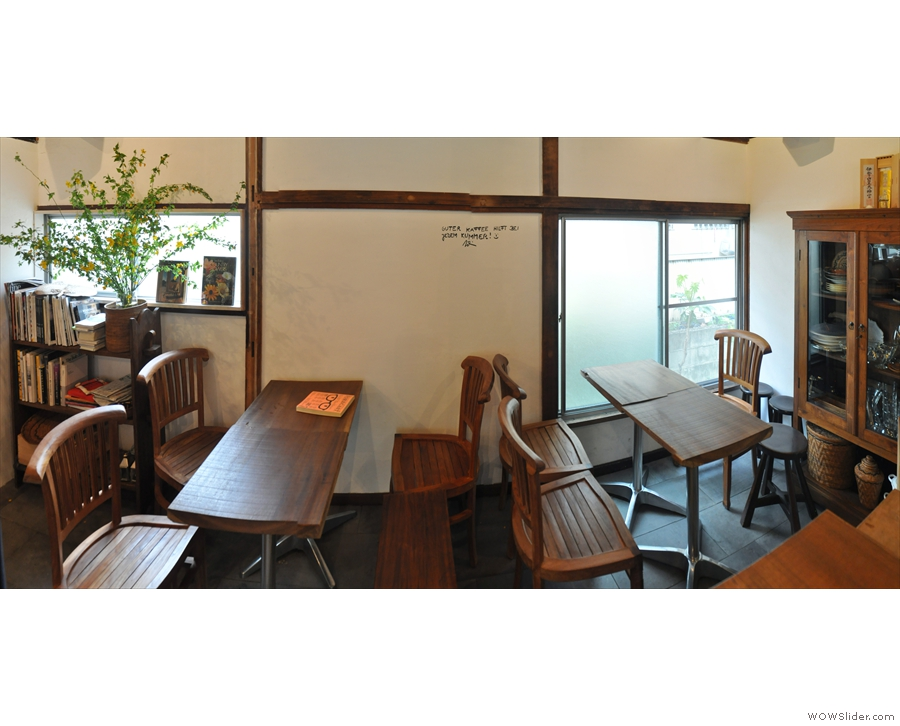 Finally, there are two four-person tables at the back, up against the wall.