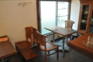 This one is on the right, beyond the counter. Again, it's a pair of two-person tables.