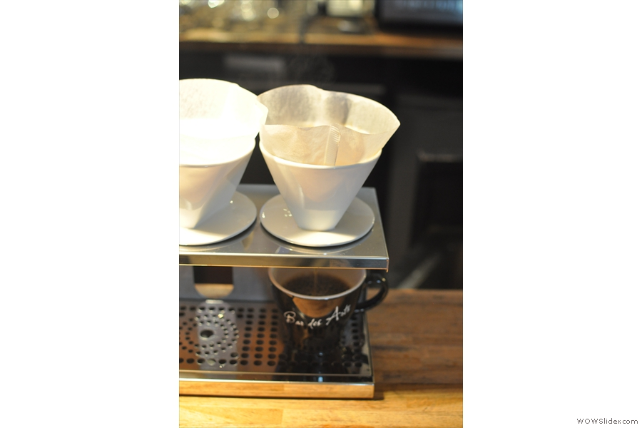 Another cup of pour-over is prepared for an interested coffee-drinker.