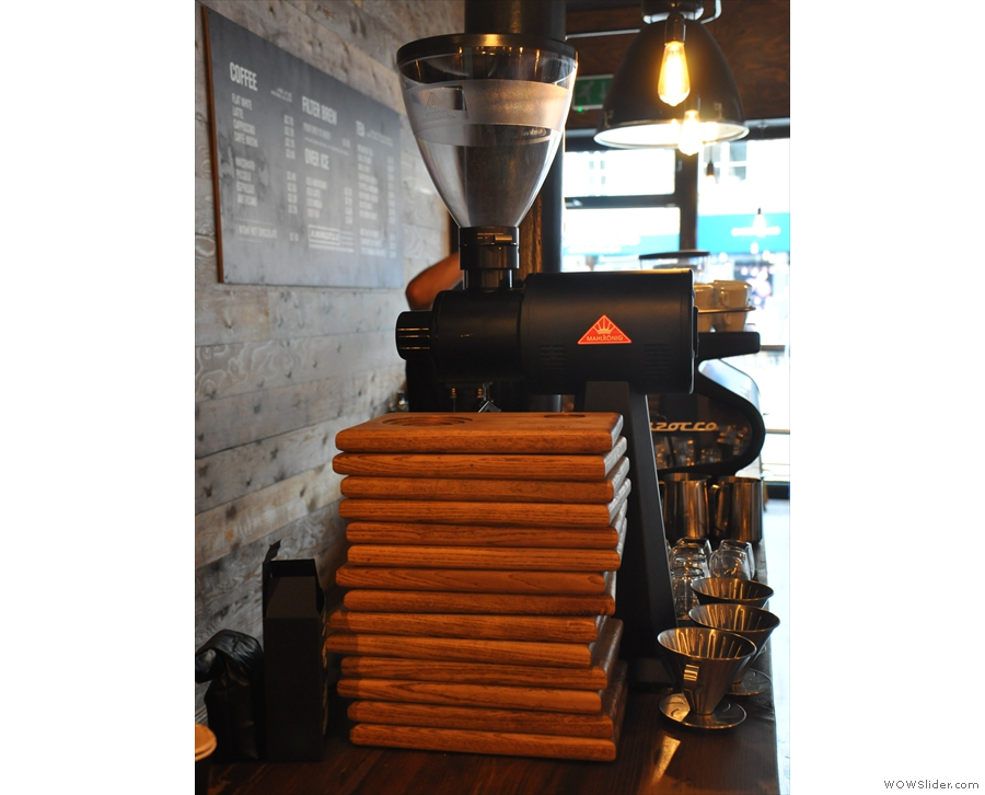 The EK-43 grinds the filter coffee, while the stack of wooden trays are used for serving.
