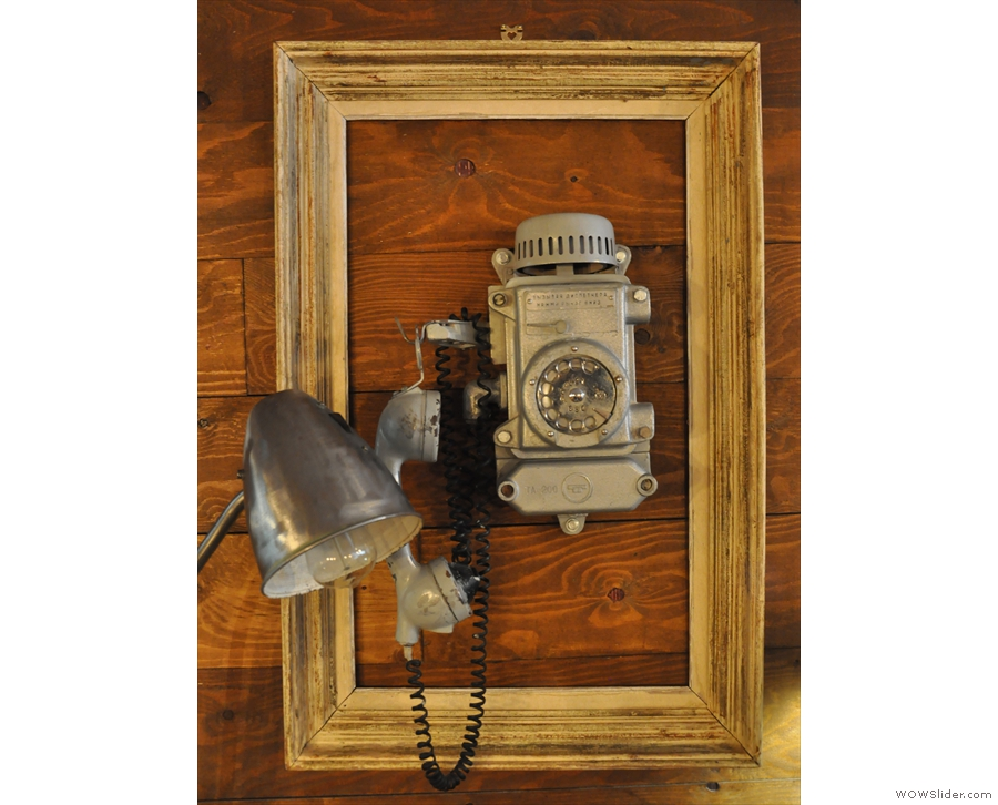 There's this old-fashioned Russian telephone on the wall...