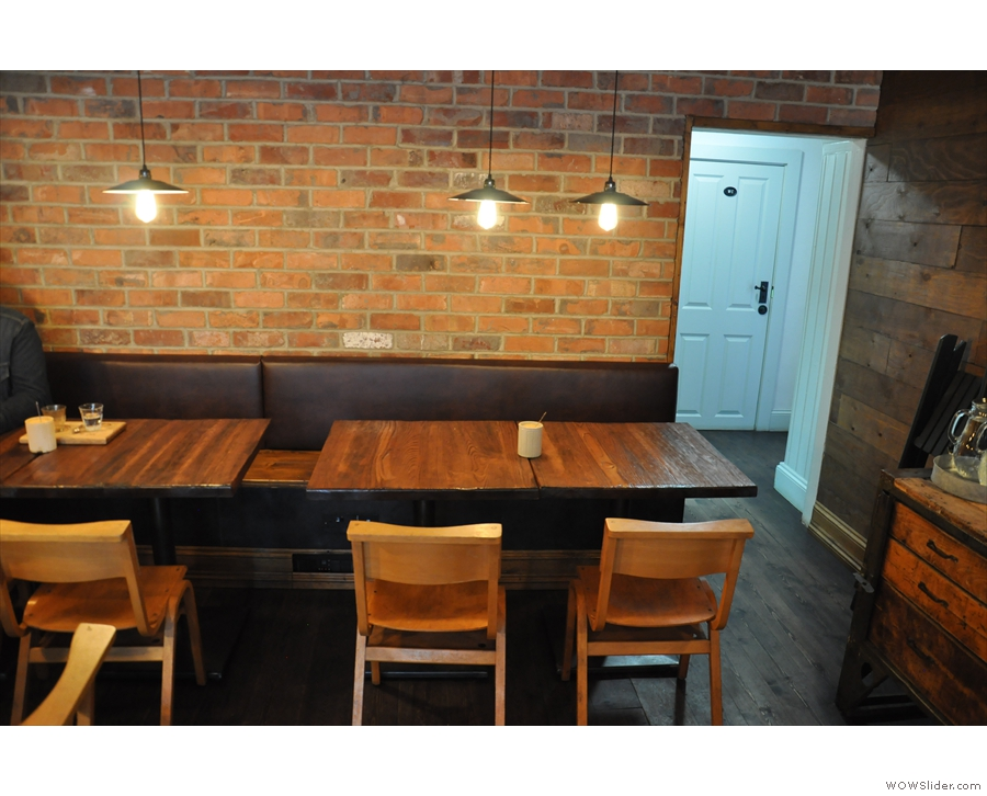 ... followed by, along the back wall, these two four-person tables.