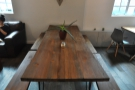 Next comes this magnificent communal table running almost the full width of the room...