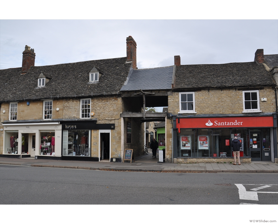 On  Witney High Street, opposite Welch Way, there's an opening between the buildings.