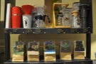Back downstairs, and there are lots of retail shelves, selling bags of coffee & coffee kit.
