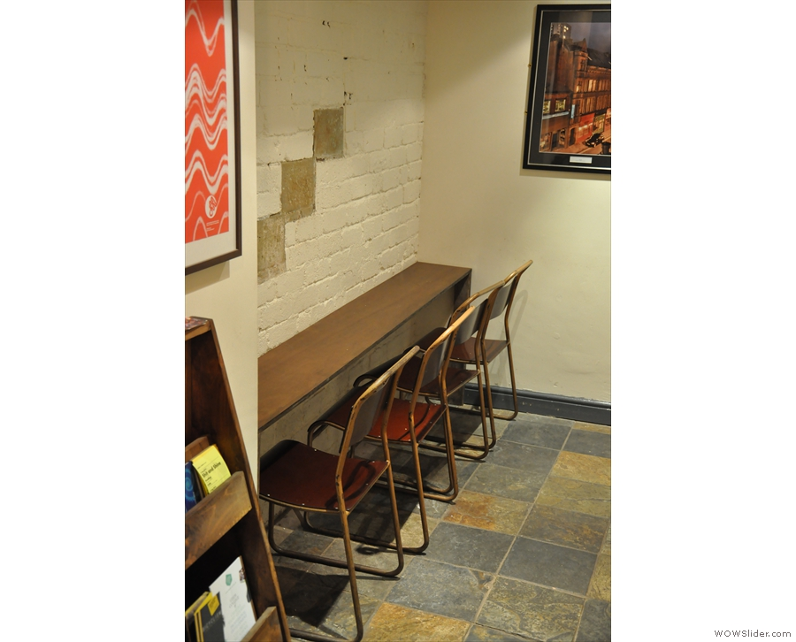 In 2014, against the opposite wall at the bottom of the stairs, was a four-seat bar...