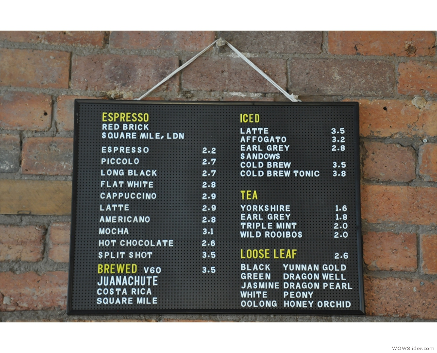 The coffee (& other drinks) menu, meanwhile, hangs on the back wall behind the counter.
