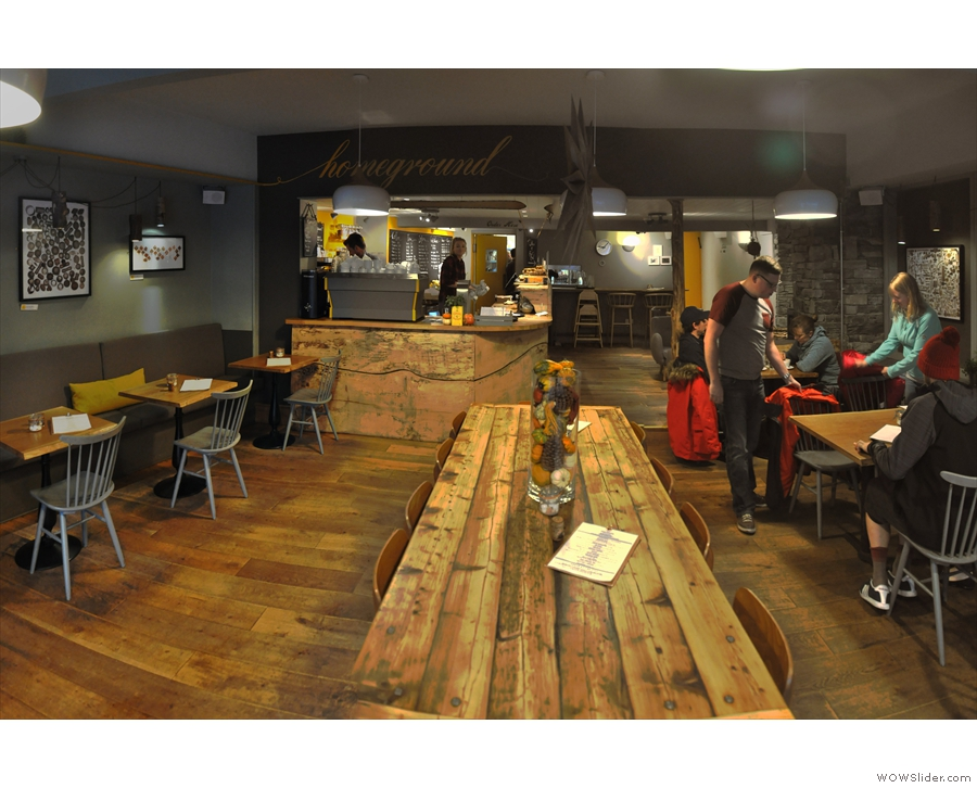 The seating is along the left- and right-hand walls, with this communal table in the centre.
