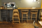 Finally, at the back, is another bar, with a couple of chairs, plus the hatch to the kitchen.