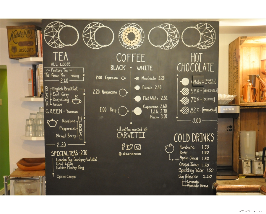 The drinks menu is on a blackboard at the back of the counter...