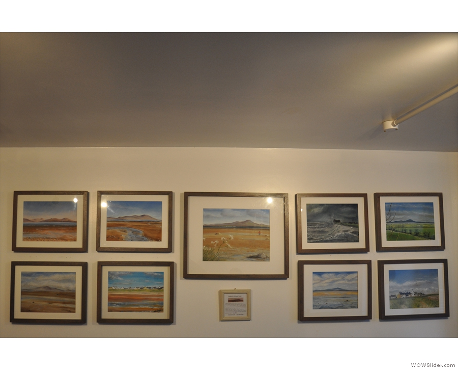 Works of art abound. These pastel sketches are on the right-hand wall above the tables.