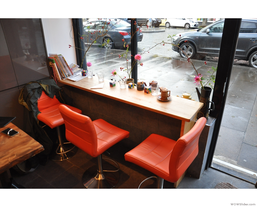 Another option is to sit inisde on one of the three comfortable chairs at the window-bar.