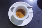 My espresso, in a classic white cup. That's all I was going to have, but my barista, Iris...
