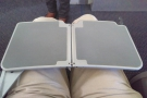 Exit row seats also mean fairly flimsy fold-out tables. It (just about) does the job!