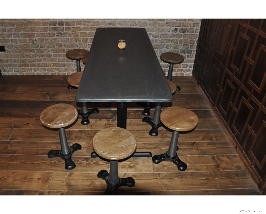 ... which has this seven-seat low table in front of it...