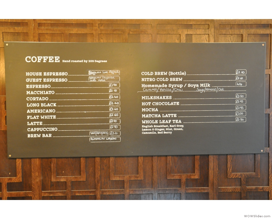 The espresso and other drinks menu is on the wall behind the counter.