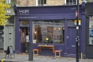 ... stands, in a familiar location, a new name in London Coffee, House of Morocco.