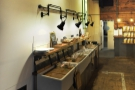 The layout is unusual, but quite logical. On the left is a long counter with the food...