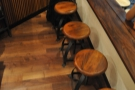 ... and then next to that, a row of five stools at the window-bar.
