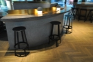 A bar runs on the outside of each of the three segments, with seating provided by stools...