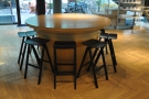 Finally, there's this round, 10-person communal table, seating provided by stools.