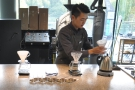 Returning the following day, I went for a pour-over. Here the barista rinses the filter papers.