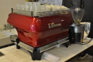 Matching the roaster, there's a red La Marzocco GB5 at the back.