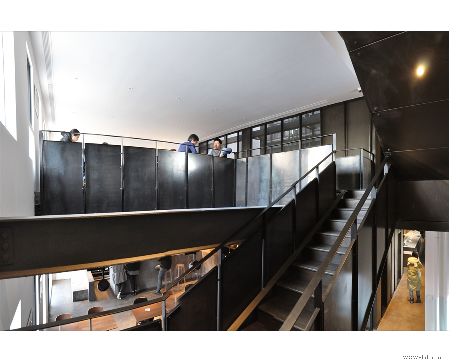 Carrying on, the stairs lead up & across to a mezzanine level above the front of The Corner.