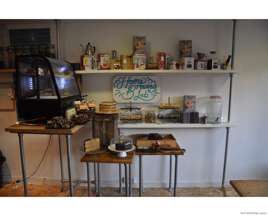 The counter, at the back on the right, is foreshadowed by the cake.