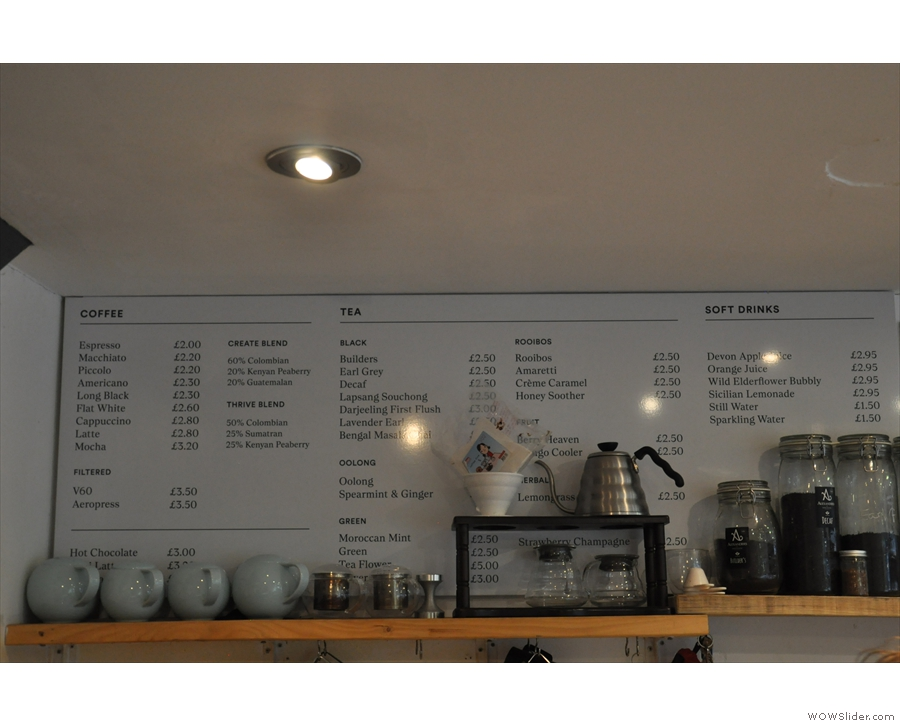 There's a conventional menu on the wall behind/above the counter...