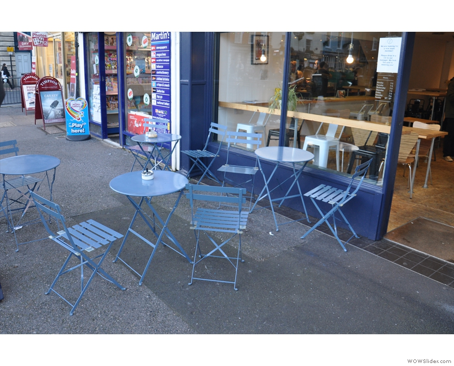 Another view of the tables on the broad pavement outside the Coffee Lab.