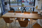 ... followed by this large, communal table which almost divides the space in two.
