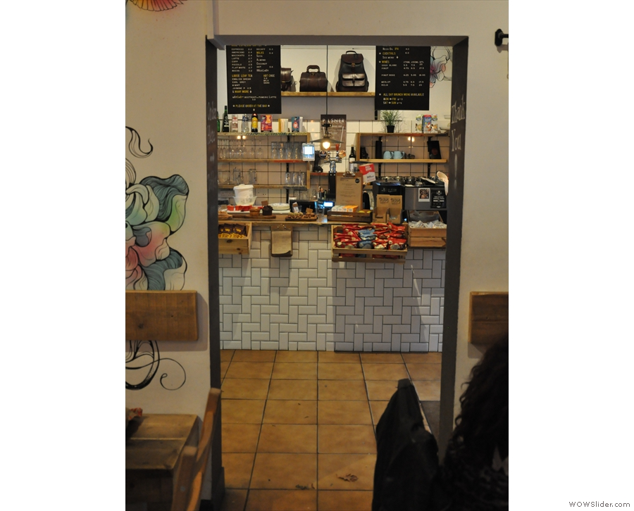 The main part of Half Cup, where you'll find the seating, is through this doorway.
