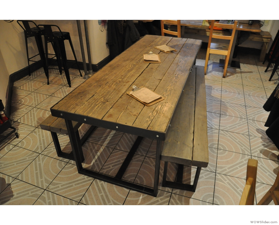 This includes a large, communal table in the centre...