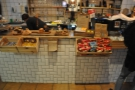 The beautifully-tiled counter is laden with goodies.