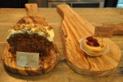 There are more cakes out on wooden platters on the counter top.