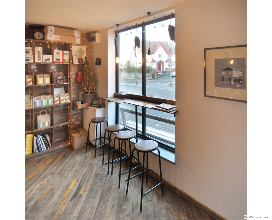 ... and, by the large window, opposite the counter, is a four-person window-bar.
