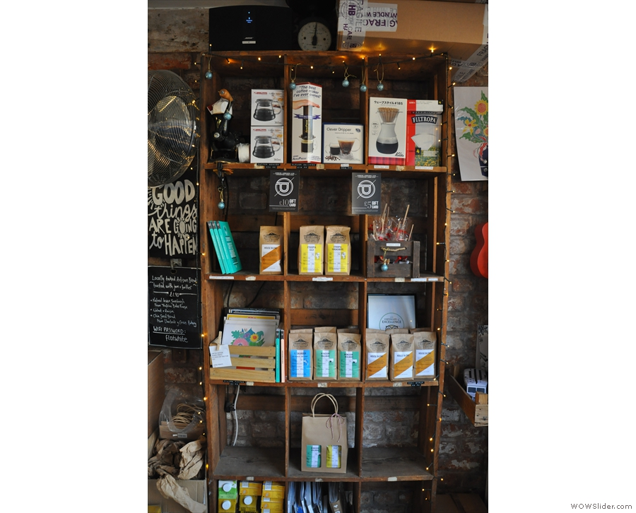 There is a set of retail shelves downstairs, selling beans and coffee-making equipment.
