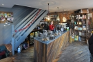 Stepping inside, you'll find a cosy downstairs dominated by the counter at the back.