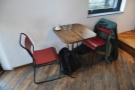 The remaining downstairs seating is a two-person table on the left-hand wall by the door.