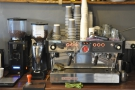 The La Marzocco espresso machine is also on the left-hand wall with its two grinders.
