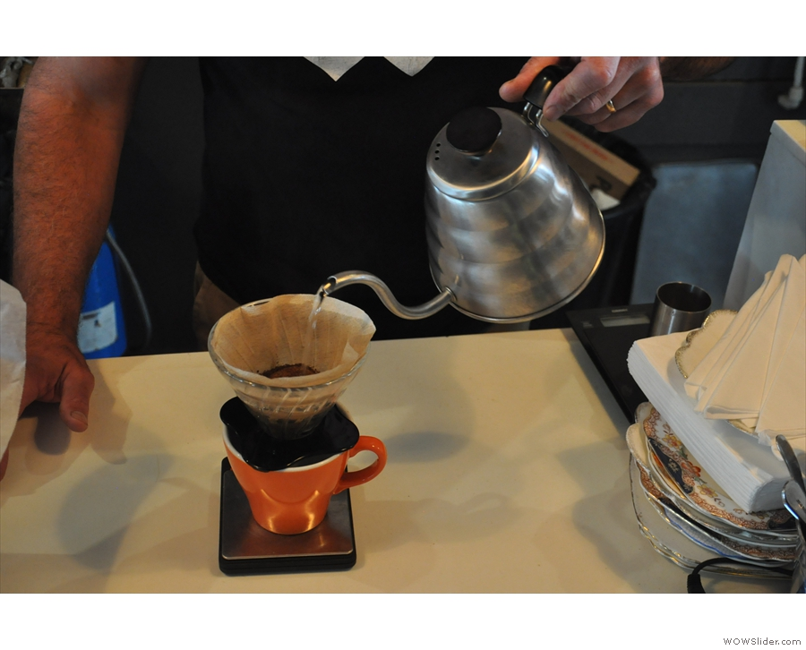 The first pour is to allow the coffee to bloom. A small amount of water is added...