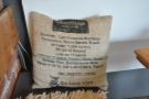 More upcycling in the shape of this cushion cover made from an old coffee sack.