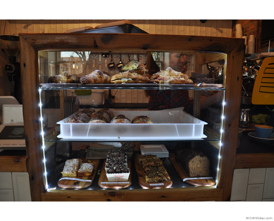 There's also a big display case in the middle of the counter which is packed full of cakes!