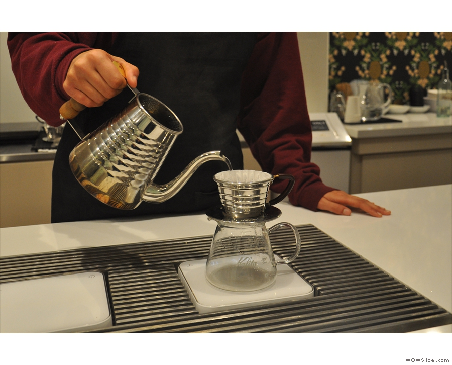 Step two, rinse the Kalita Wave filter, pre-warming the carafe in the process.