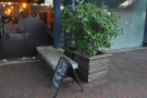 There's a small, outside seating area, with a concrete bench to the right...