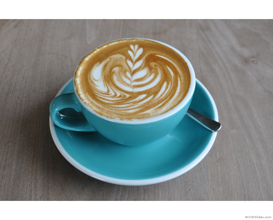 My flat white, with some excellent latte art, in a lovely blue cup.