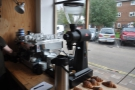 The espresso machine in the window has a Mythos 1 grinder, plus an EK-43...