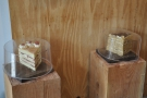 There are also some short, wooden pillars used to display the cakes...