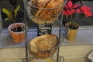 Coffeesmith also sells loaves of bread, available from these baskets by the door.